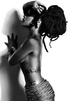 Natural hair, smooth dark skin, tattoos and creative use of rope!