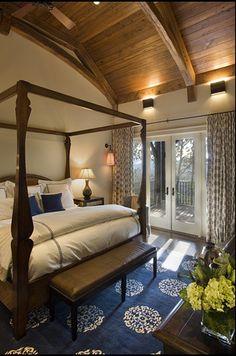 Navy blue  ecru bedroom with vaulted wood ceiling -- Madeline Weinrib Blue Mandala Tibetan Carpet -- Photo: Jay Weiland Photography