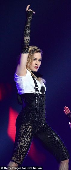 Madonna rocks her style with the help of B Akerlund. Gloves by #steampunkwolf #madonna #rebel #heart