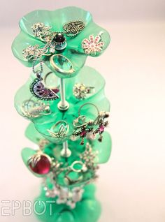 A jewelry stand made from bottoms of various size pop bottles, nuts, washers and hollow tubes. via Popular Pix