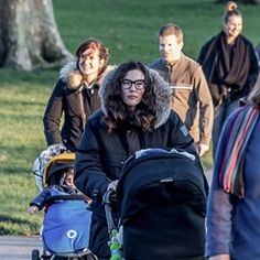 Liv Tyler takes her daughter for a walk in the park in London