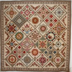A beautiful sampler pattern inspired by a Quaker family quilt circa 1840s.  This quilt offers a fabulous combination of piecing, applique and broderie perse.