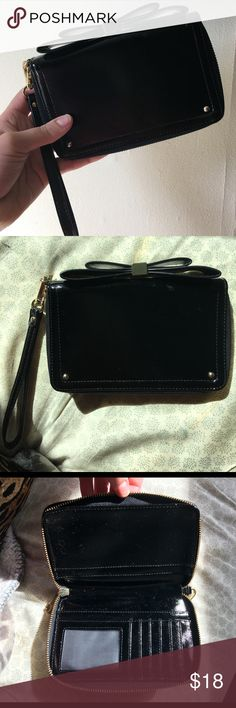 Aldo Phone Wristlet Black patent leather wristlet. Large enough to carry phone. Never used. Complete with credit card and id slots and cute bow accent outside. Removable wristlet attachment to use as everyday wallet. Aldo Bags Wallets