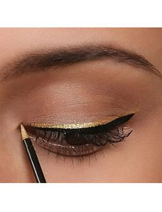 Glitter liner on top of black. quickchange makeup from peasant to lumiere with just a swipe!