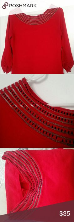 Gorgeous red party top It has a round neck with bead work. Wore only once. Tops