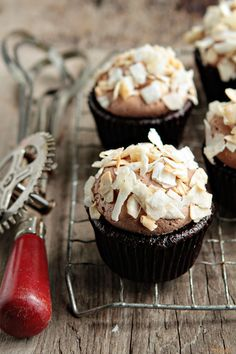 """Coconut-Mocha Cupcakes"".... Rich, coffee infused cupcakes topped with mocha buttercream and toasted coconut."