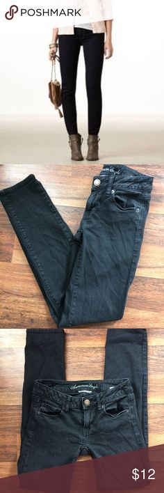 """American Eagle black skinny jeans American Eagle black skinny jeans in size 0 short (inseam is approx 28"""") perfect for the summer with a pair of flats or sandals American Eagle Outfitters Jeans Skinny"""