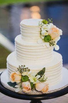 White wedding cake idea - three-tier white wedding cake with textured frosting and peach roses + white orchids - destination tropical wedding cake idea {Kpix Photography}