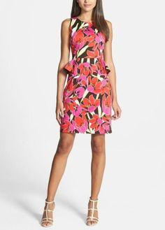 Party time! This tropical print peplum sheath dress will turn heads this summer.