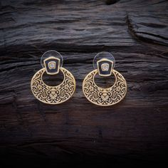 Stylish Design CZ Zircon Stud earrings studded with synthetic stones, with gold Polish.