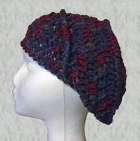 This is an original design that is unique and fun. This hat was made to be a little slouchy and was crocheted with a soft 75% acrylic and 25% wool blend yarn with different shades of burgundy, dark blue, teal, and hints of browns and greys.It h...