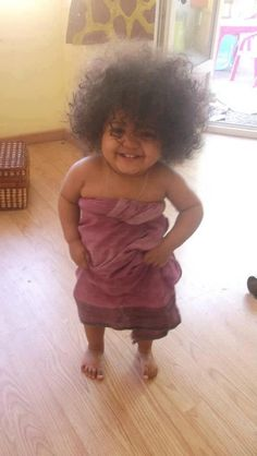 This girl gives me hope that happiness can overcome the craziest of hair days.