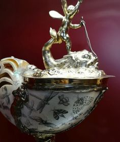 Nautilus cup with coat of arms of abbot Aleksander Kęsowski by Andreas I Mackensen in Gdańsk (mounting) and Jean Bellekin in Amsterdam (engraving), 1643-1667, Museum of Decorative Arts in Berlin. © Marcin Latka #fragment #nautilus #cup #abbot #aleksanderkesowski #andreasmackensen #gdansk #mounting #jeanbellekin #amsterdam #engraving #artinpl #museum #decorative #berlin #gilt #insects #oliwa Nautilus, Art Decor, Commonwealth, Christmas Ornaments, Holiday Decor, Amsterdam, Berlin, Insects, Arms