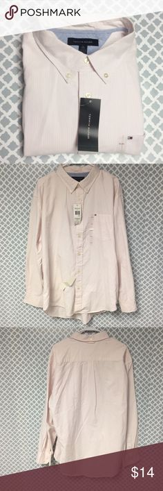 NWT Tommy Hilfiger Button Down Description: Tommy Hilfiger Men's Size XL New with Tags Pink and White Vertical Striped Button Down Shirt  🔘Condition: New with Tags – Several stains from storage, but should wash out. I have lowered price due to defect.   🔘Material: 100% Cotton  🔘Measurements:       Pit to Pit – 27 inches       Shoulder to Hem – 29 inches    ⭐️ 15% Off All Bundles! 🛍    💞Thanks for stopping by! 😘 Inventory: B Tommy Hilfiger Shirts Casual Button Down Shirts