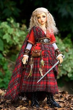 Brigit, Celtic Goddess of Fire- hightop leather boots, plaid skirt,,,empire high waist, belt, shirt sleeves, gold tirm on sleeves, leather wrist braces, leather and fabric pouch