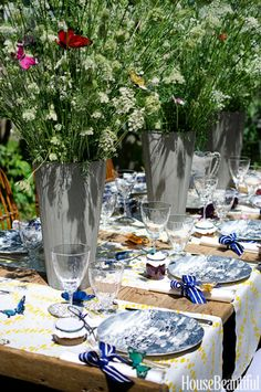 Textile designer Michael Devine conjured a romantic alfresco fete. He wired fanciful faux butterflies into the floral arrangements, making them look as if they're fluttering throughout the Queen Anne's lace. Click through for more summer party ideas and details that make a difference.