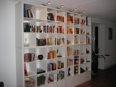 Materials: Four Expedit 4×4, some inserts, and a father-in-law Description: In our new house we wanted a big bookcase up to the ceiling. We figured we could fit 7 Expedit-size compartments (height). My father-in-law (Bas) was confident he could knock out 1 row of compartments to build our custom wall of Expedits. And so he [&hellip