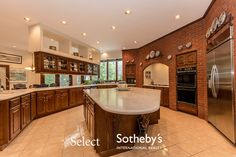 6907 Shalimar Way, Fayetteville NY.  Exposed brick in the #kitchen  #selectsothebysinternationalrealty #NYrealestate