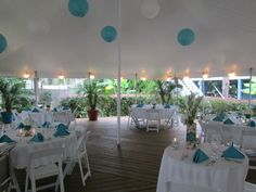Aqua/Teal and White Wedding Reception under tent surrounded by Tropical Plants Beach Wedding