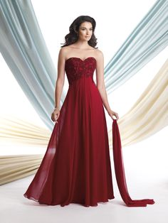 Strapless chiffon A-line gown with sweetheart neckline, floral hand-beaded bodice with center gathered Empire waistline. Matching shawl and removable straps included. Sizes: 4 – 20
