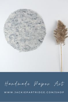 Handmade paper art for your home by artist Jackie Partridge. Handmade denim and abaca circular paper ships unframed. Choose a frame to match your style and hang this grogeous minimal art in your home. Art for the walls perfect for a beach house or minimal style.#handmadepaper #jackiepartridge #handmadepaperart Click the link to save 15% on artwork now!
