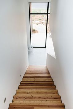 Wooden stairs, white walls