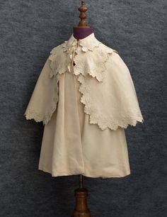child's embroidered silk coat with cape, c. 1910. make children's winter cloaks layered like this?