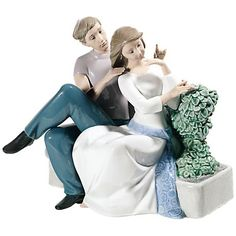 In a classic look with modern styling, this hand-crafted porcelain sculpture in rich blue and green with white and neutral tones depicts the timelessness of a couple in love.