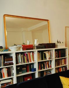 Knock off of a $300 mirror. Ogdin photo frame from IKEA with mirror cut to fit, spray painted gold, or gold leafed.