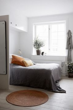 A gray bedspread that creates a soothing vibe.