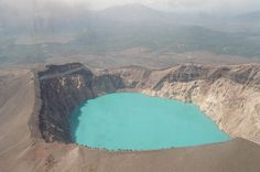 Maly Semyachik Crater Lake  The azure blue colouring is caused by the acidic water.