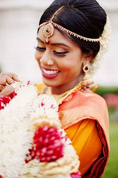 Stunning Indian bridal style | Photo by Ovyian Photography via http://junebugweddings.com/wedding-blog/circus-inspired-wedding-red-rose-convention-centre/