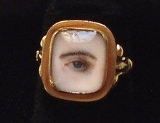 """A """"Lovers' eye"""" ring,  which, like the brooches, was popular in the late 18th century. The first """"Lovers Eyes"""" belonged to the Prince of Wales, later crowned King George IV of England and his lover Maria Fitzherbert, a commoner whom he later married.  They were made to be worn discretely as a secret love token."""