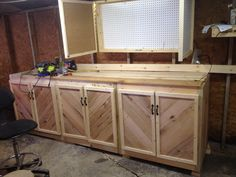 Cabinets made from pallets---would like doors like this on the potting bench I am making for my front porch....