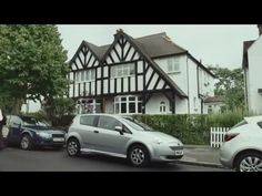 John Cleese re-creates a Faulty Towers sketch where he gives a car a 'thrashing'.
