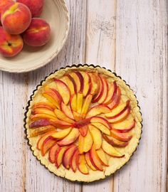Try this yummy peach tart for your next dinner party dessert. Put an organic twist on it by using wholesome, organic ingredients. Mini Tart Pans, Peach Slices, Organic Sugar, Edible Flowers, Pistachio, Almond, Vanilla, Rolls, Baking