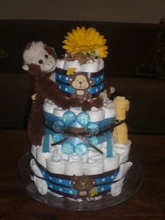 Items similar to Monkey Diaper Cake Jungle Theme Baby Shower Centerpiece or gift elephant available and other ribbon colors too on Etsy Safari Diaper Cakes, Monkey Diaper Cakes, Baby Shower Themes, Baby Boy Shower, Baby Showers, Shower Ideas, Mnm Cake, Cake Show, Jungle Theme