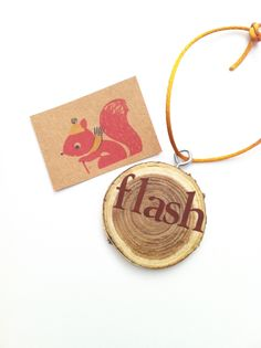 """Sage says, """"This Flash wood slice ornament is so very flashmobbian. BAM!"""""""