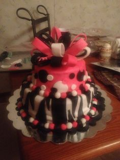 Pink and zebra baby shower cake