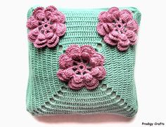 Hand-made crocheted Pillow, green. One of a kind, this is my own design, you will not find the same one anywhere else!  Decorated with flowers. Comes with a pillow inside (not just a pillow case)!  Pillow case is removable and washable. $39.99