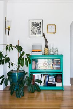Chris and Amber's Old + New Renovated Home — House Tour | Apartment Therapy; patina green on a barrister bookcase would be awesome!
