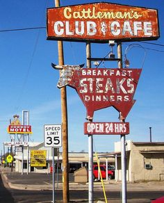 Vintage signs for the Cattleman's Club & Cafe in Amarillo, Texas. Cattleman's has been in business since 1961.