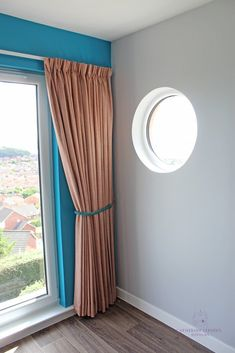 Find out how I created bespoke window treatments & soft furnishings in rust & teal for a luxury B&B in Fife like these pencil pleat curtains with a contrast rope tieback & a round porthole window  #BespokeCurtains #Teal #Rust #InteriorDesign #WindowTreatments #SoftFurnshings #Tieback