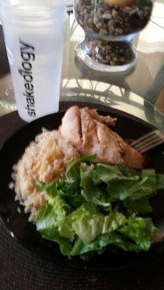Brown rice, chicken breast an green salad.