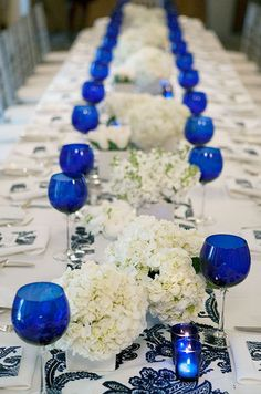 Featured Photographer: Fan Jiang; Uniquely chic wedding reception idea with blue wine glasses and candles