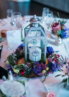 Whimsical Silver Lantern Wedding Reception Centerpiece With Wildflower Wreath | Photo: AMC Photography | Flowers: Verbena Designs, Inc. |