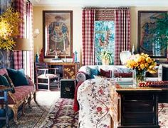 Designed by Michael S. Smith -- cozy Eaton Check curtains in claret. Antique Italian loveseat covered in Lisbon Stripe in red. Both fabrics by the designer Cowtan & Tout. A pair of sofas is upholstered in Le Grand Genois Multicolore from Pierre Frey.