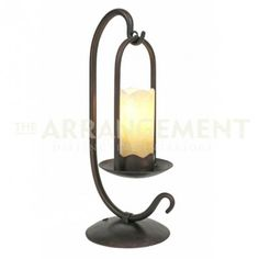 """Iron Candle Table Lamp  Reminiscent of lanterns from the old West. An iron base and frame support an alabaster stone that looks like a lit candle. 23"""" tall and perfect for adding some light to your mountain or cabin home."""