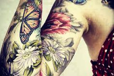 Check out this amazing butterfly tattoo on hand..