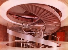 c. 1960 Nestlé Headquarters -Double spiral central staircase|Vevey, Switzerland |Colorama Photograph Milk chocolate was invented inVeveyby Daniel Peter in 1875.- Via